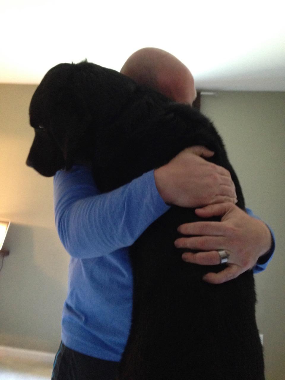 dog veteran hug