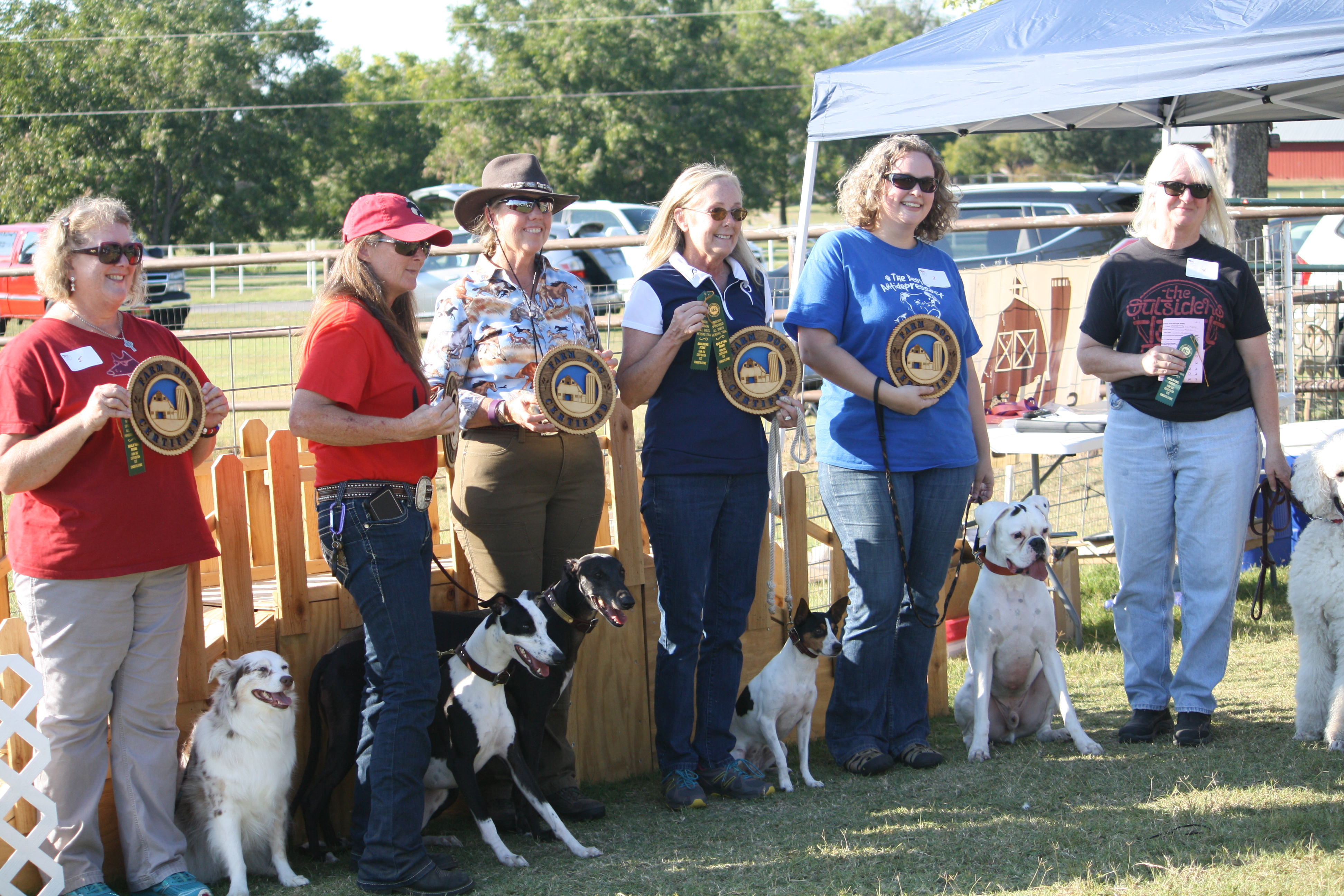 Handlers pose with Certified Farm Dogs