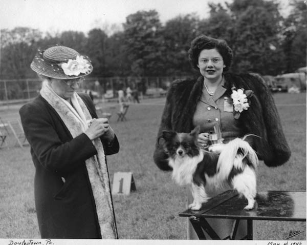 Mrs. Rachel Kemmerer (left) and her Papillon Ch. Minuet of Dulceda with judge Anna Katherine Nicholas in 1946.