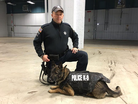 FWPD's Django sporting his new bullet proof vest and accompanying officer.